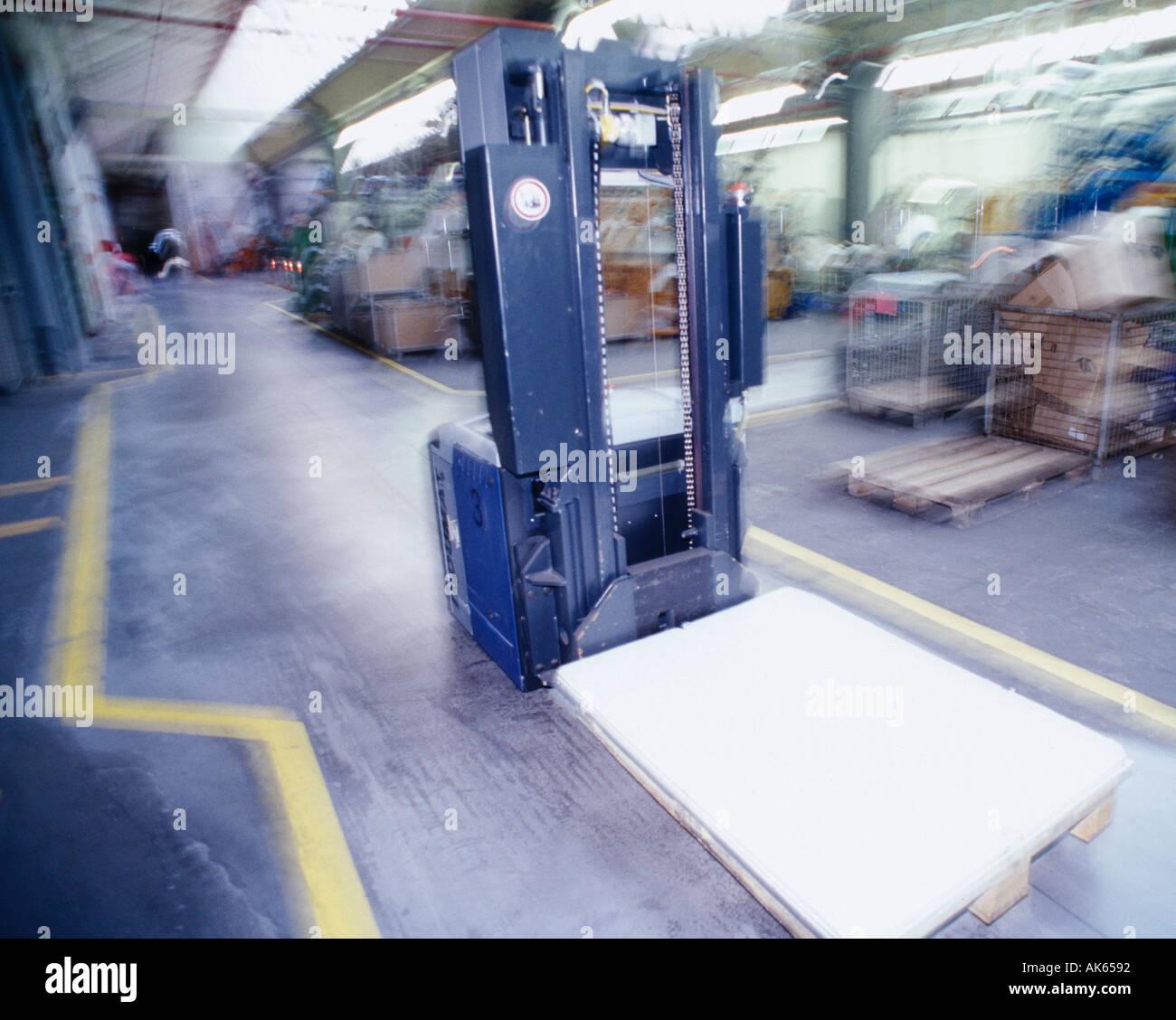 Robot forklift truck in warehouse Hannover Lower Saxony Germany Roboter Gabelstapler in Lagerhalle Hannover Niedersachsen Stock Photo