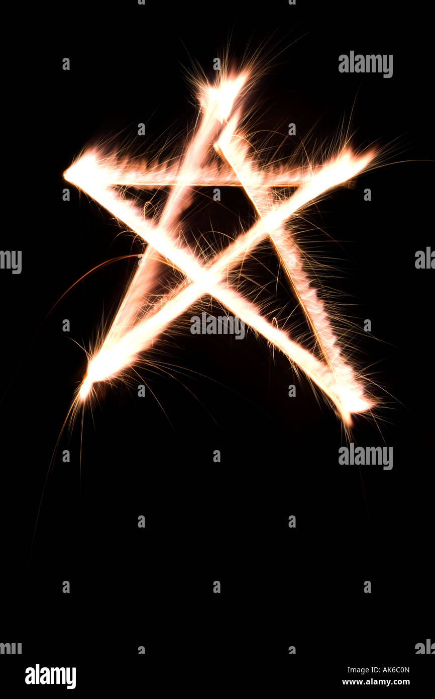 Five pointed star Drawn in the air with a sparkler - Stock Image