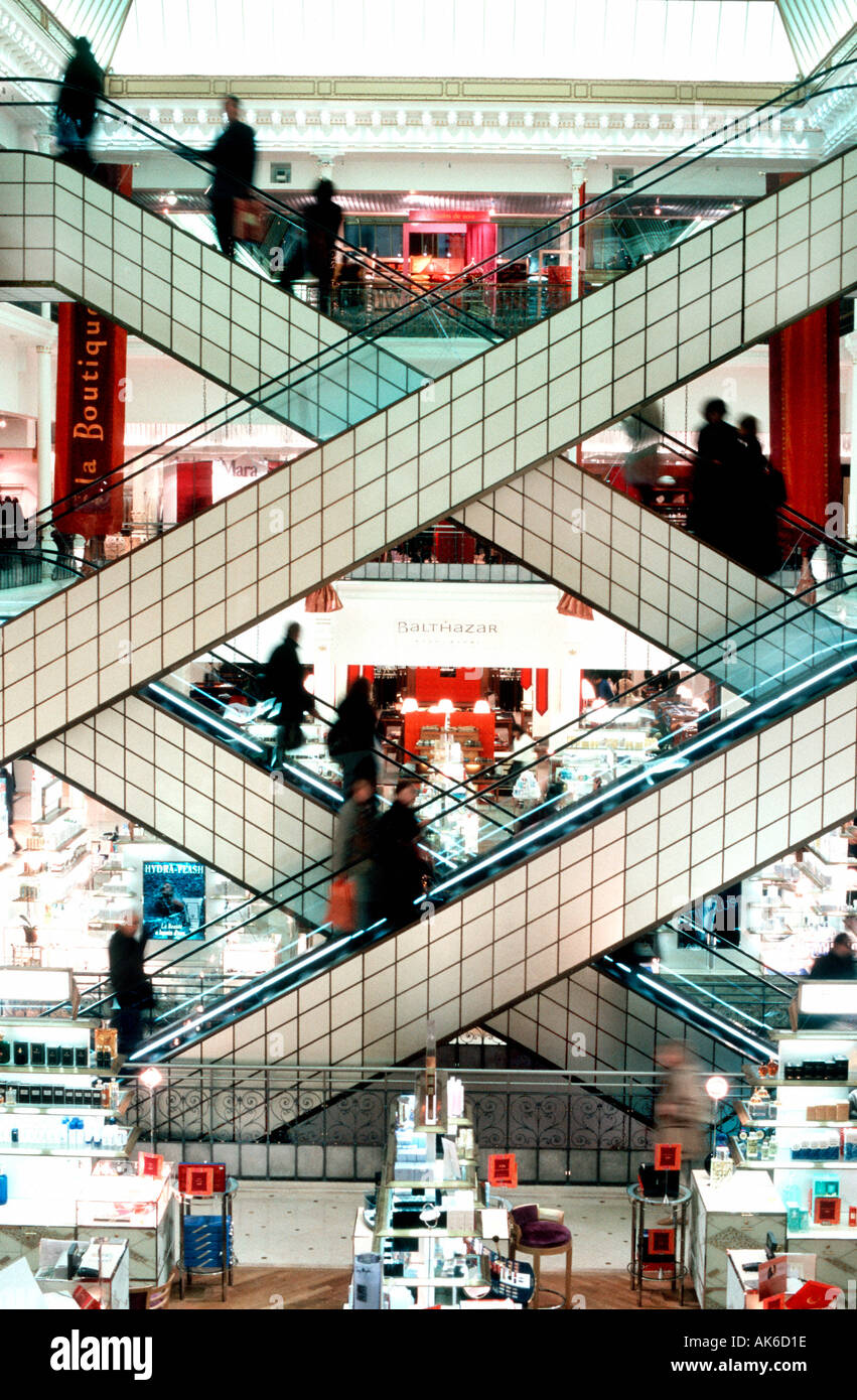 Paris France, French Department Stores, 'Le Bon Marche' , Main Escalator Interior people Shopping Inside Crossed Stairway - Stock Image