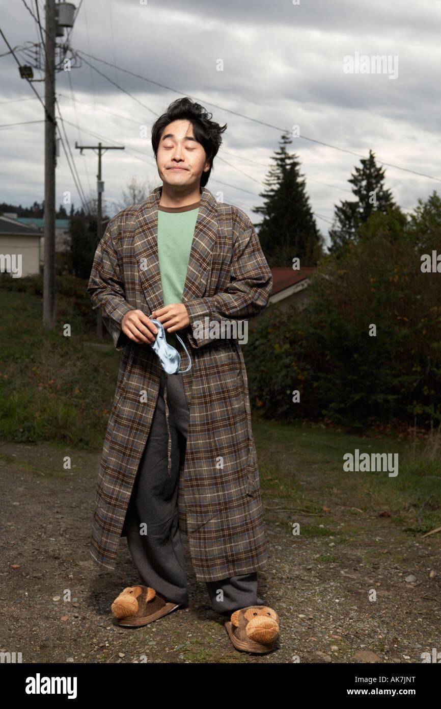 Sleepwalking Man Standing in Neighborhood Alley - Stock Image