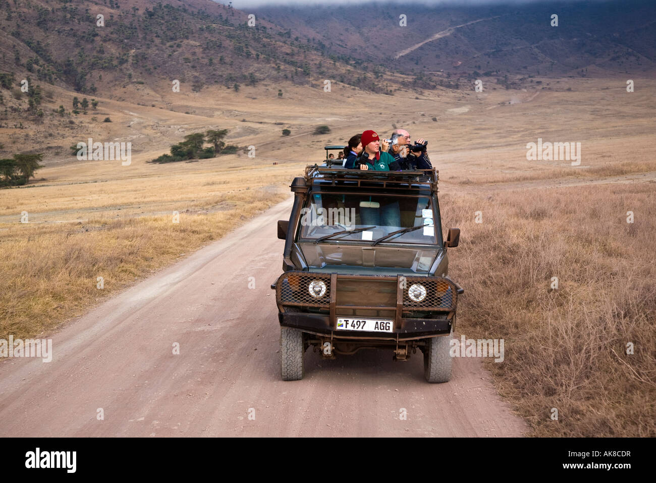 A group of tourists on an early morning Game drive in the Ngorongoro Crater, Tanzania, East Africa. 2007 - Stock Image
