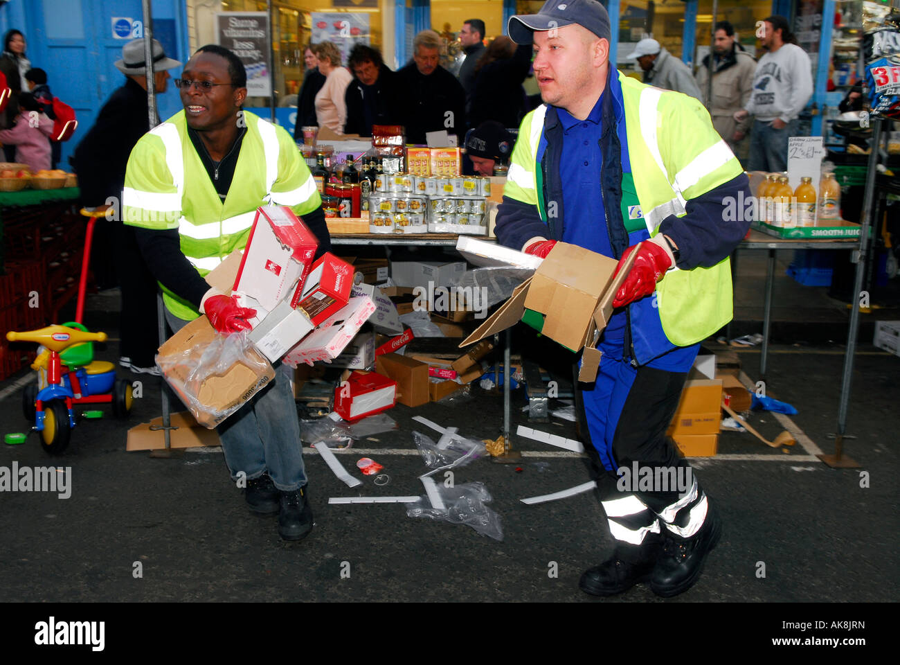 Local Authority workers collecting rubbish from Portobello Market Portobello Road Westminster London UK - Stock Image