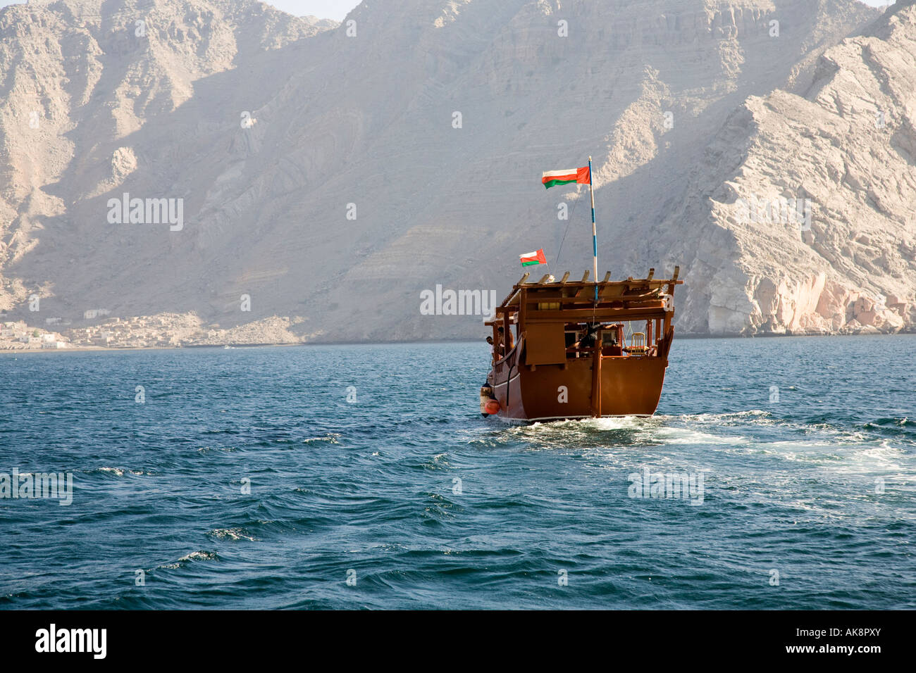 Arab Tourist charter boat at sea, Oman Dolphin Watching & coastal cruise, an Arabian Dhow in waters off the - Stock Image