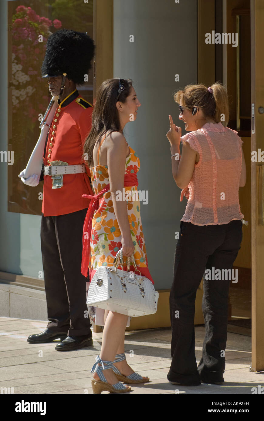 Shoppers And Grenadier Guarding Shop Entrance At 2 Rodeo Drive, Beverly  Hills, California,