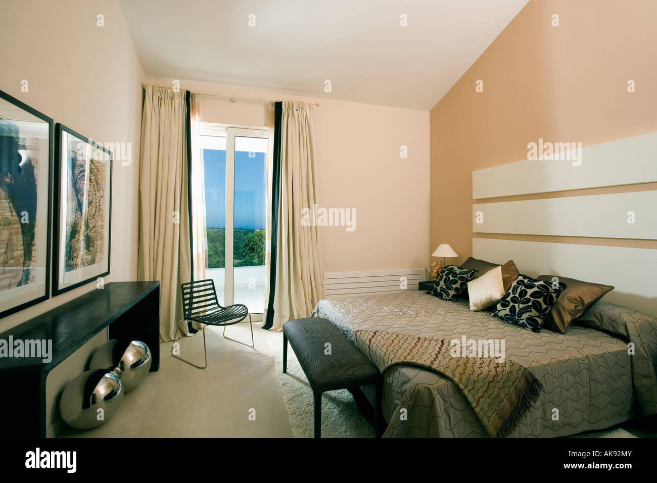 Cream Curtains At French Doors In Modern Bedroom In Spanish Apartment Stock Photo: 14925146