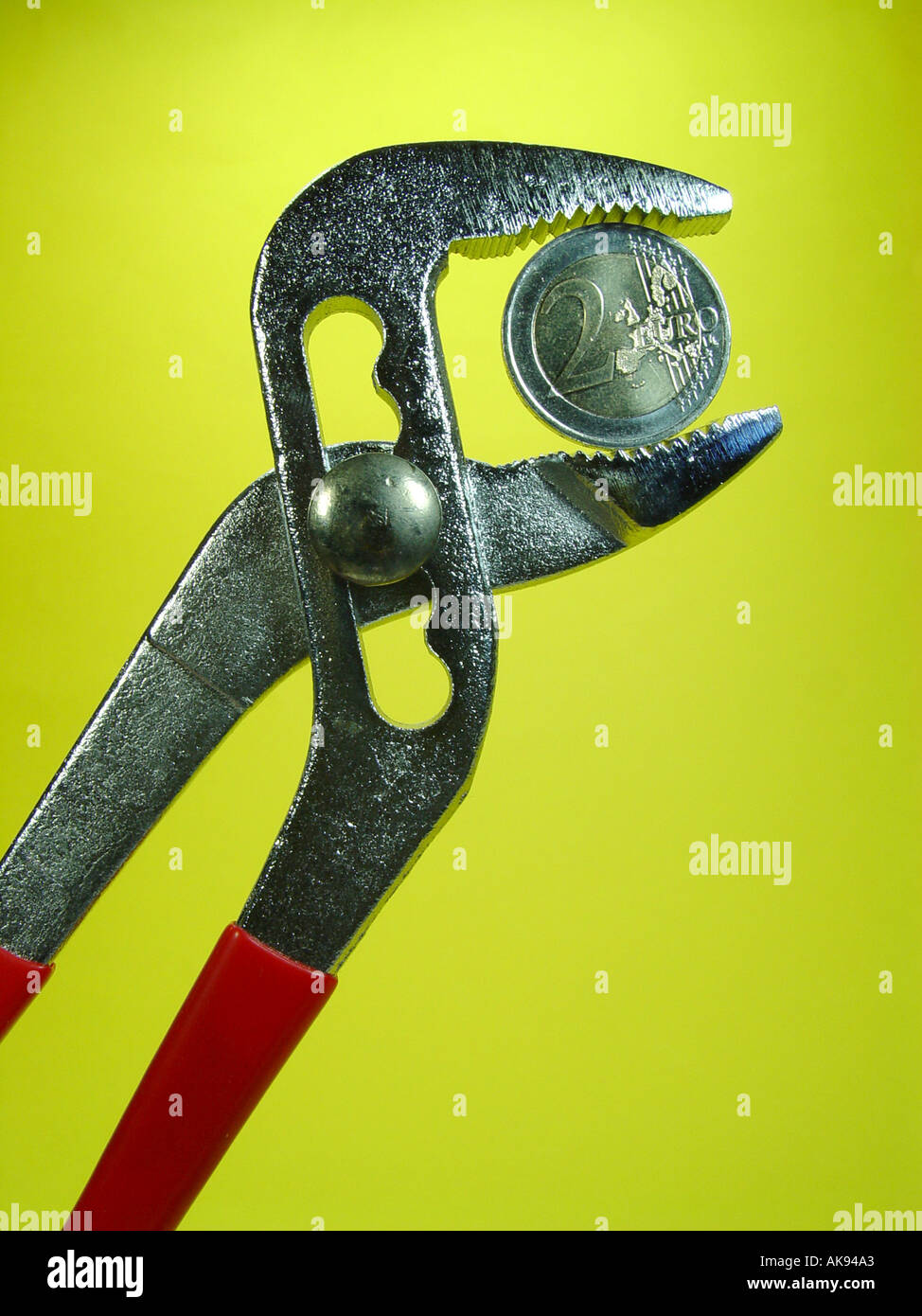 Euro In The Pliers As Symbol For Exchange Rate Fluctuations In The