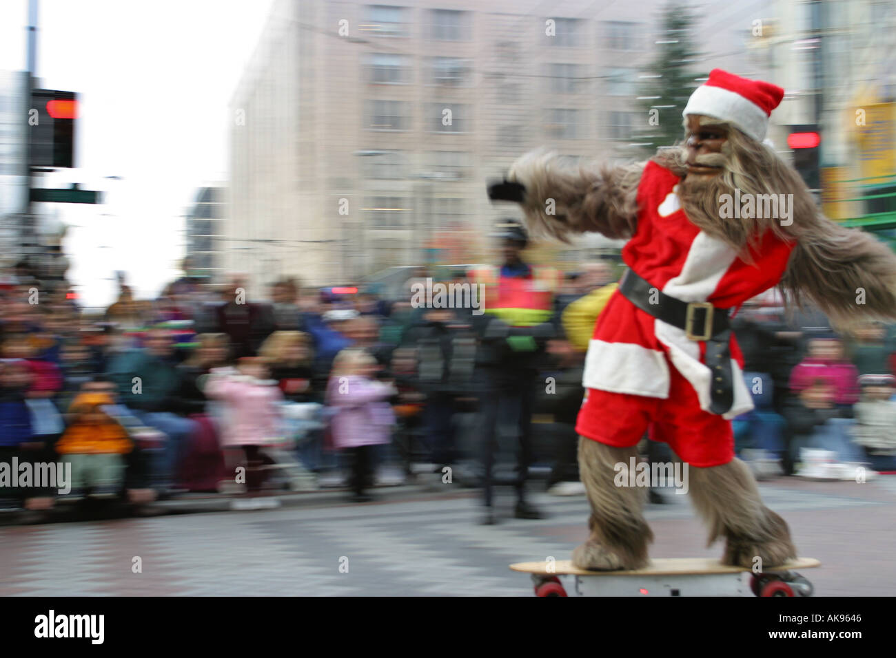 Wheedle the Sonics Basketball team mascot on skateboard in Christmas holiday parade on Fifth Avenue Seattle Washington - Stock Image