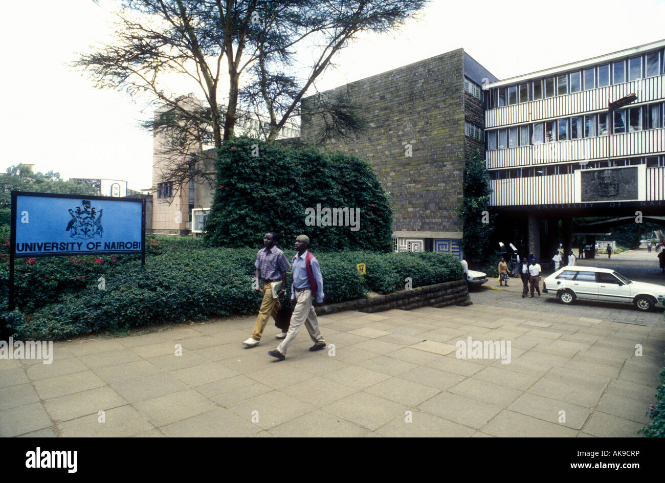 Two male students stride out of the Faculty of Arts of Nairobi University Nairobi Kenya East Africa - Stock Image