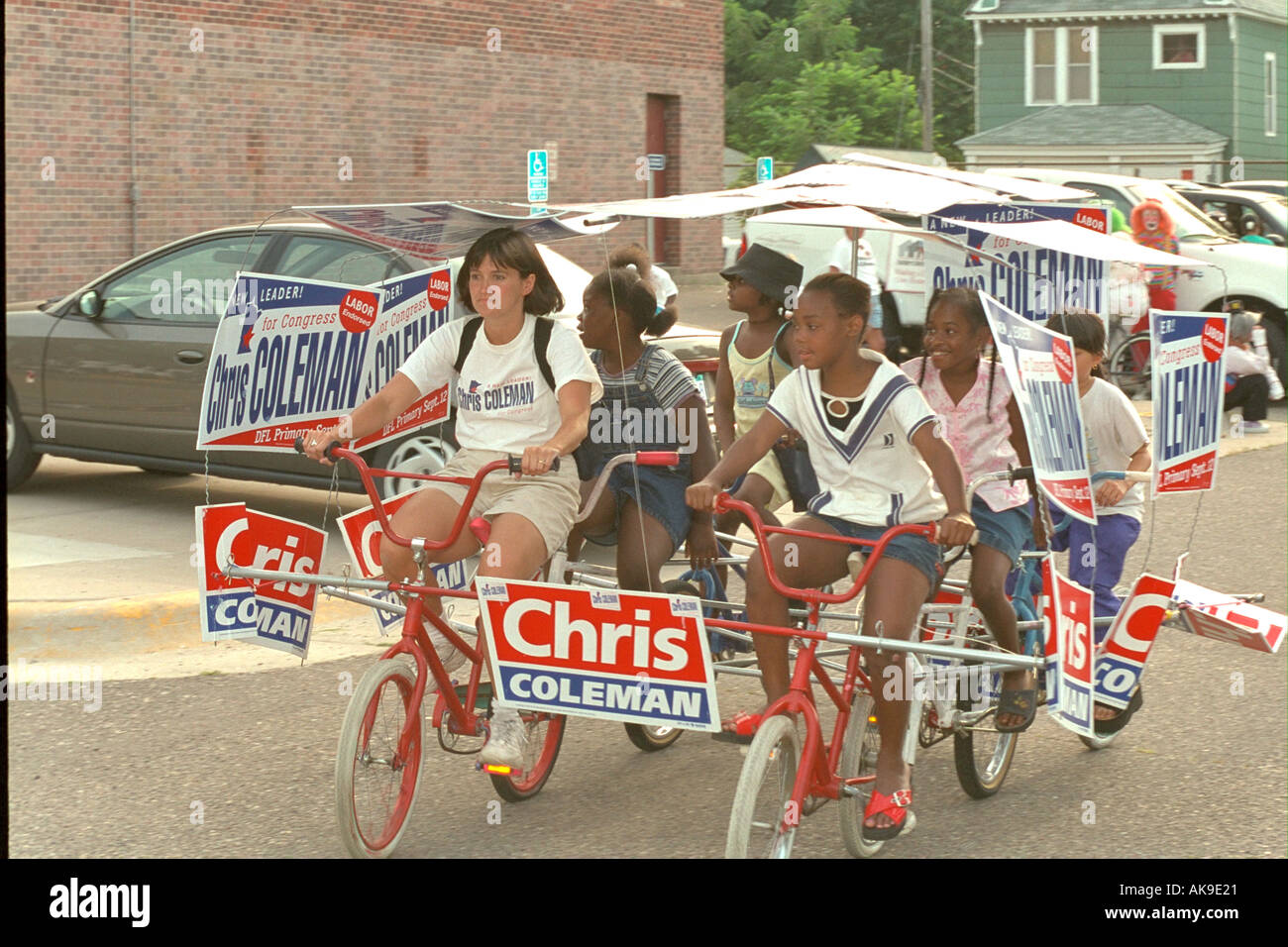 Political campaigners age 12 and 28 riding bikes in the