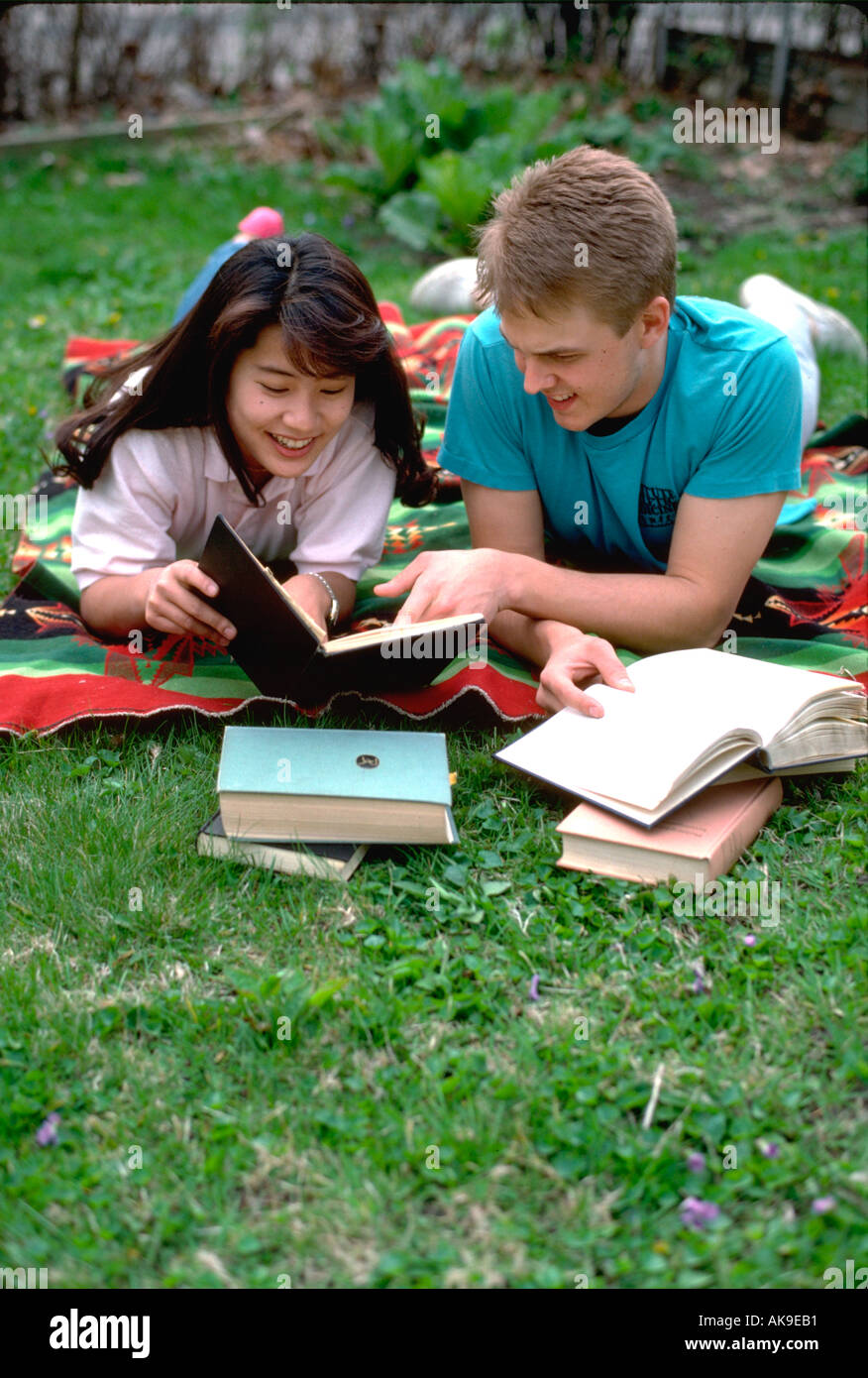 Japanese student & US host, age 18 studying English in his yard. St Paul Minnesota USA Stock Photo