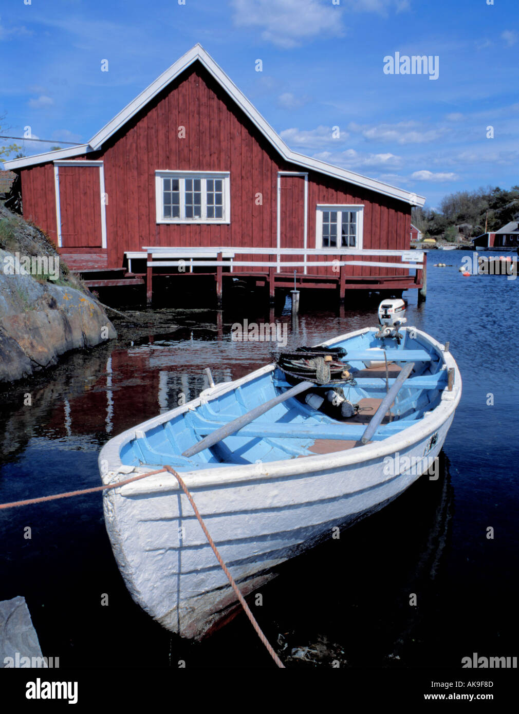 Old Wooden Rowing Boat And Waterside Wooden Hut Homborsund Stock