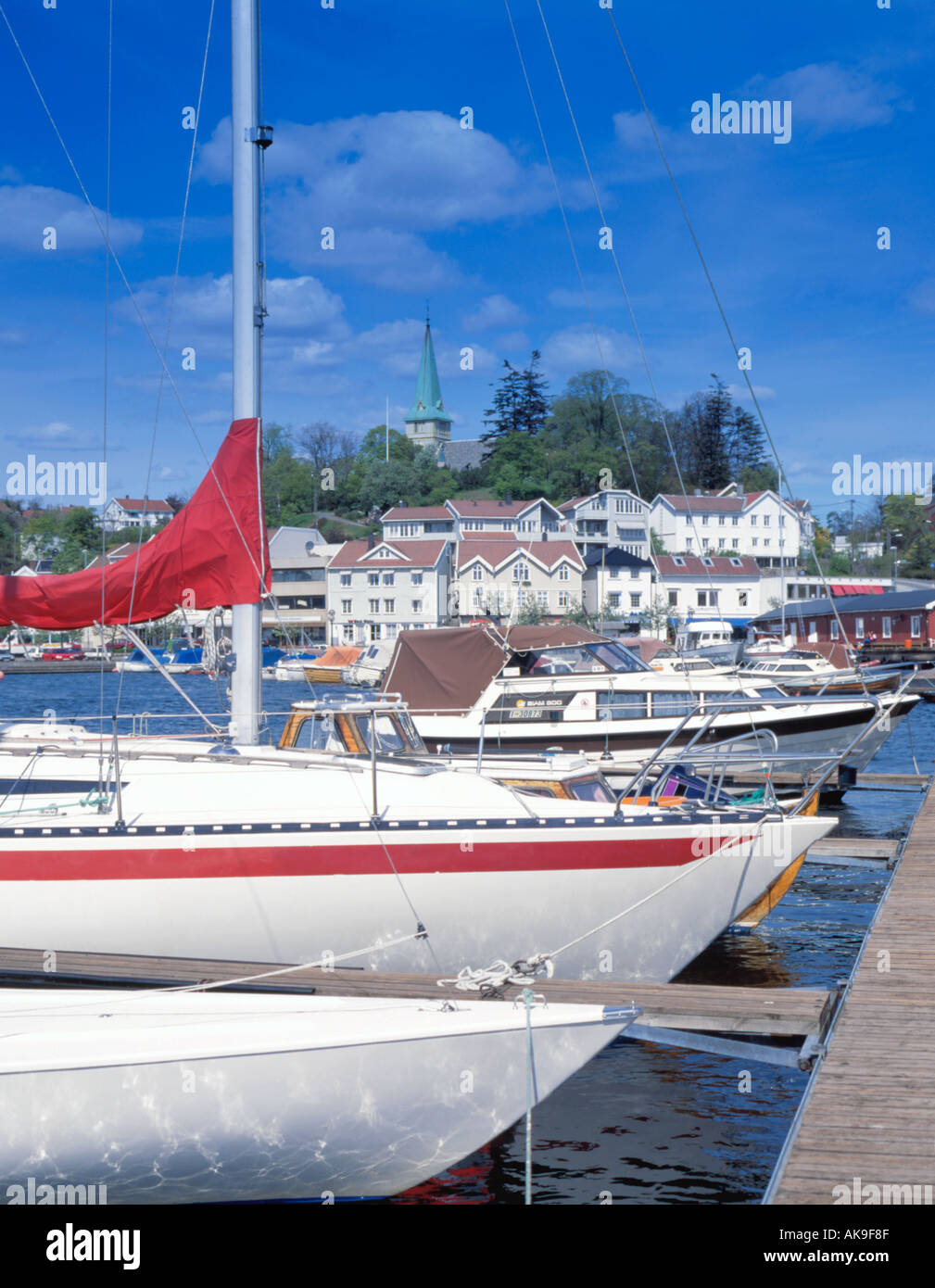 View over fibreglass hulled boats and harbour, Grimstad, Aust-Agder, Norway. - Stock Image