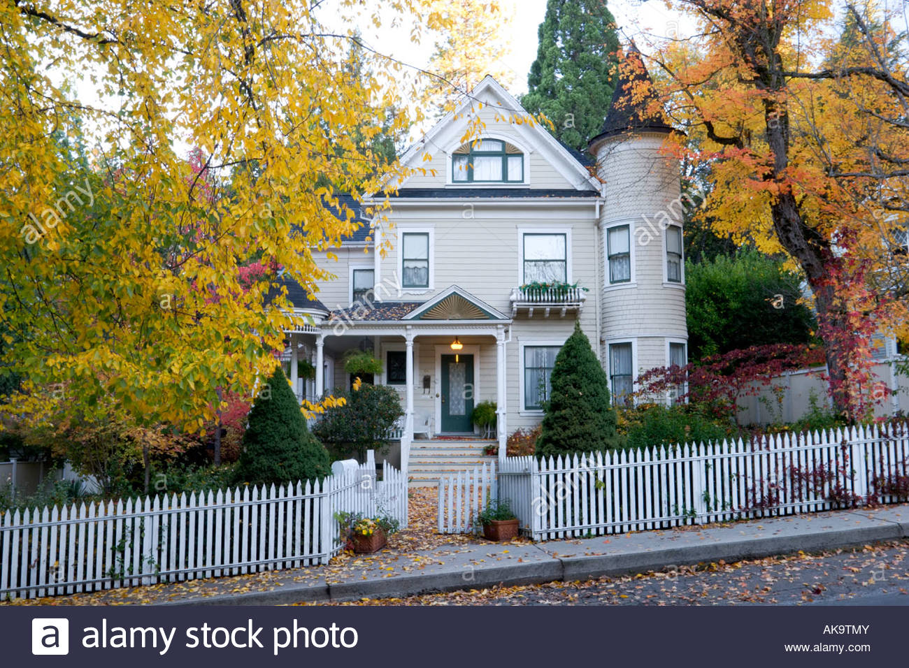 Victorian Home with Fall Foliage Nevada City California - Stock Image