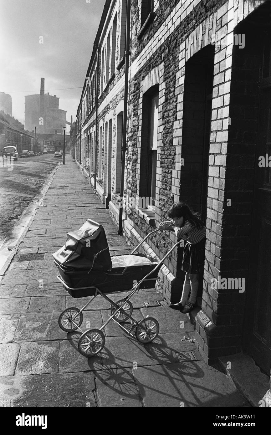 Girl minding a baby, Splott, Cardiff ,Wales, 1974 Stock Photo