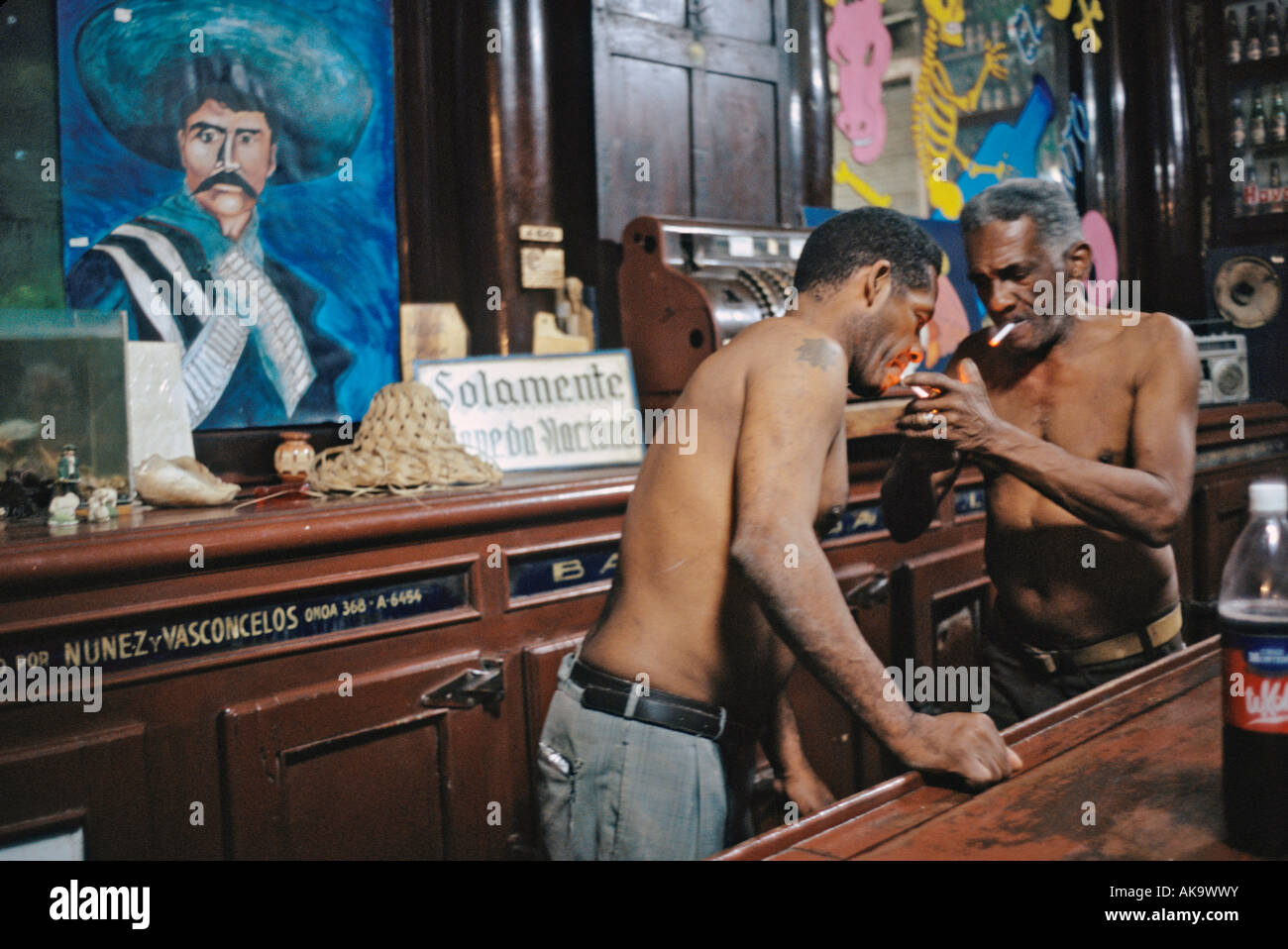 Men take a cigarette break from cleaning up in a bar. Havana Cuba - Stock Image