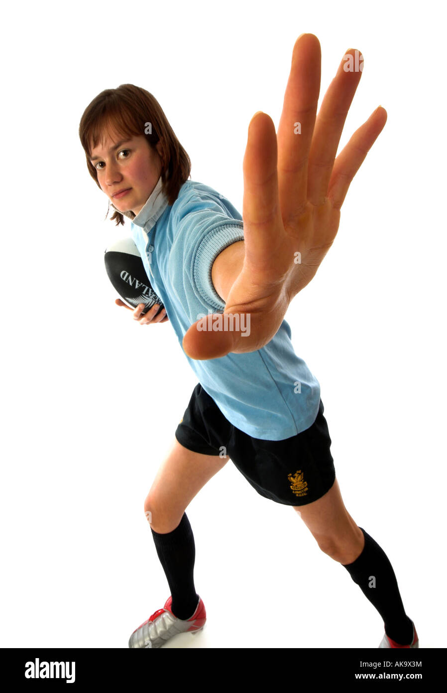 Fending Off concept in a young woman Rugby player demonstrating the handoff - Stock Image