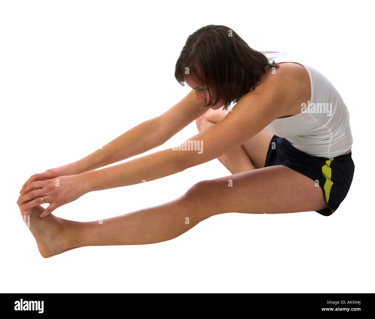 A young woman doing stretching exercises - Stock Image