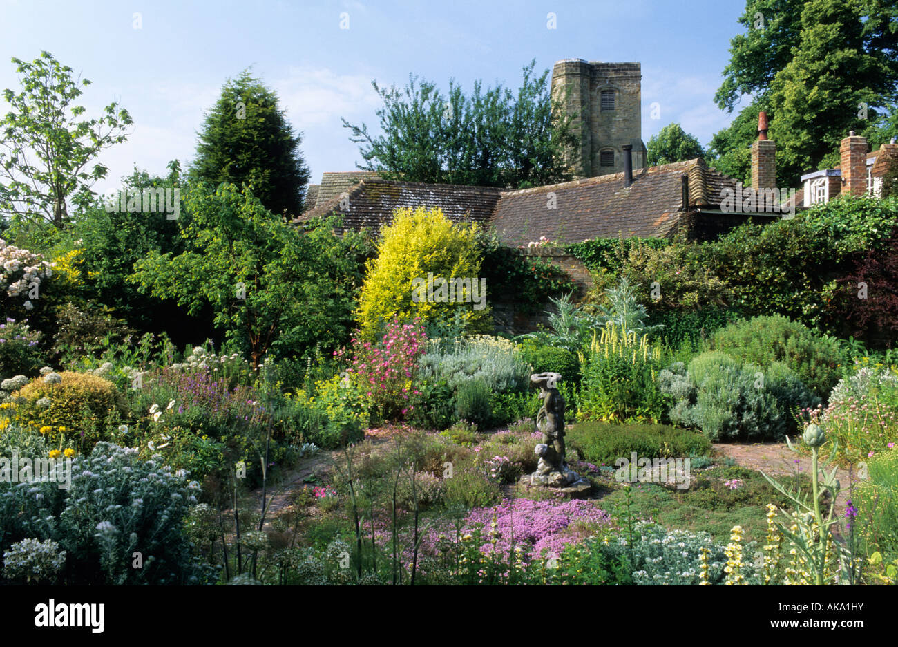 private garden Sussex herb garden with thyme and antique statue as focal point - Stock Image