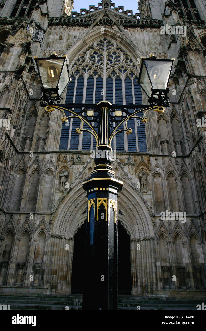 Ornate street lamp in front of new West Window at York Minster York - Stock Image