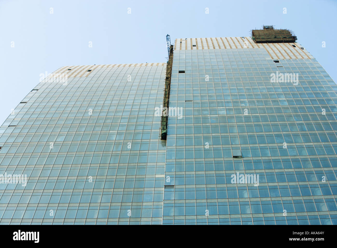China, Guangdong Province, Guangzhou, office building under construction, low angle view - Stock Image