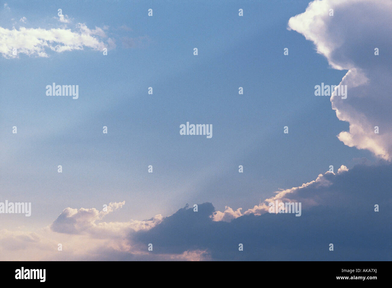 Skyscape with clouds and beams of sunlight - Stock Image