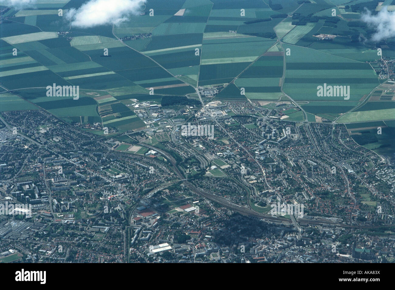 Aerial view of urbanized area bordering on rural fields - Stock Image