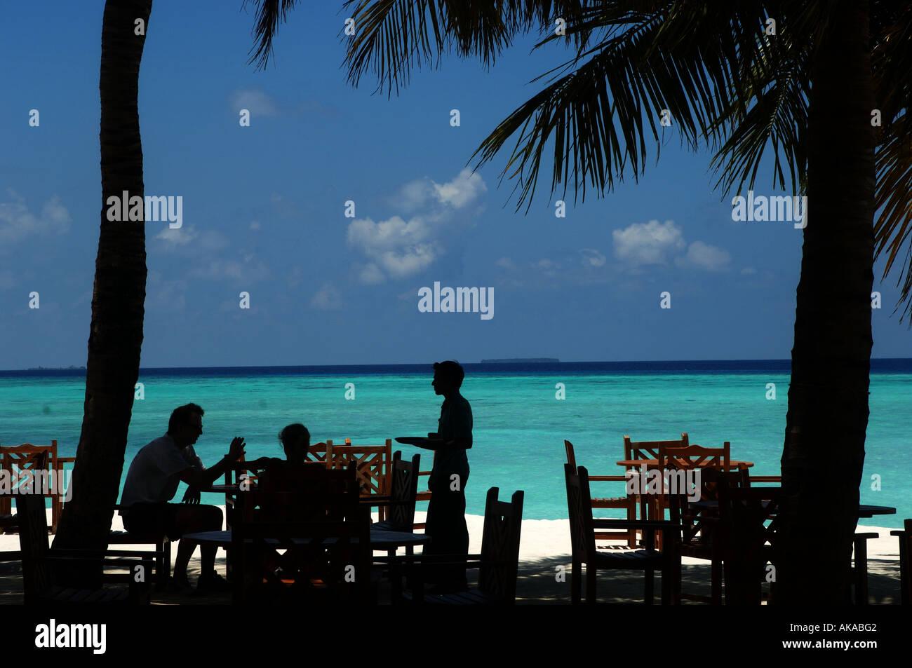 Maldives waiter of the beach restaurant of the Sun island resort - Stock Image