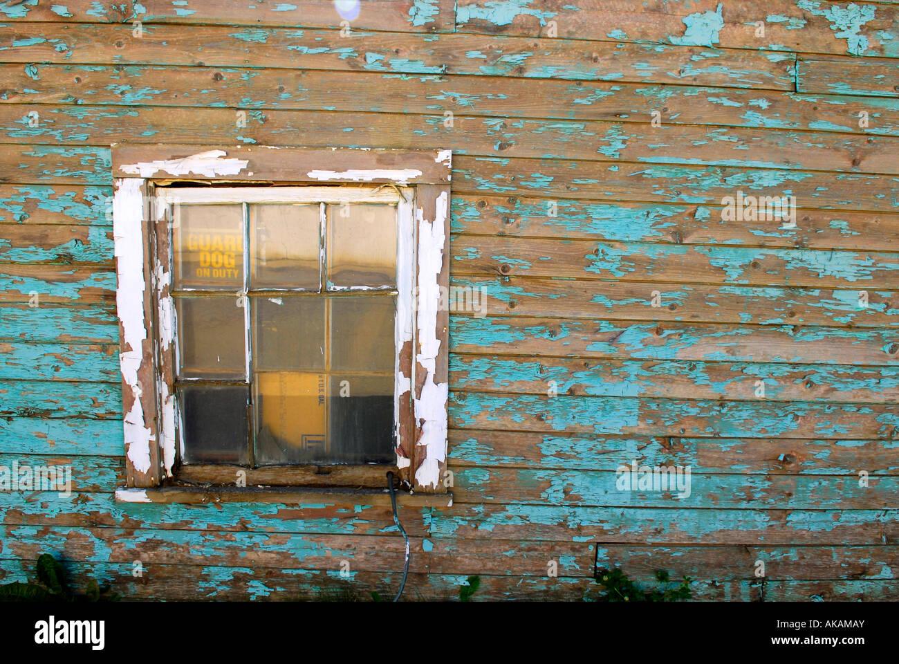 Old Building Peeling Peel Paint Worn Disrepair Town of Hythe Alberta Canada Blue Green Aqua - Stock Image