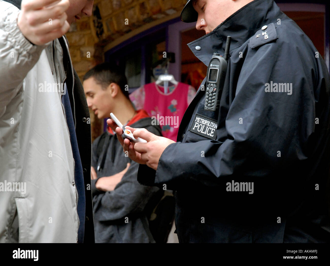 police officer stop and search youth. - Stock Image
