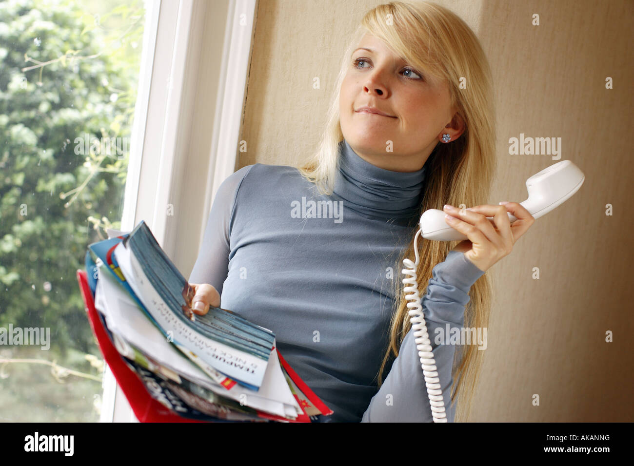 woman on the telephone making enquiries - Stock Image