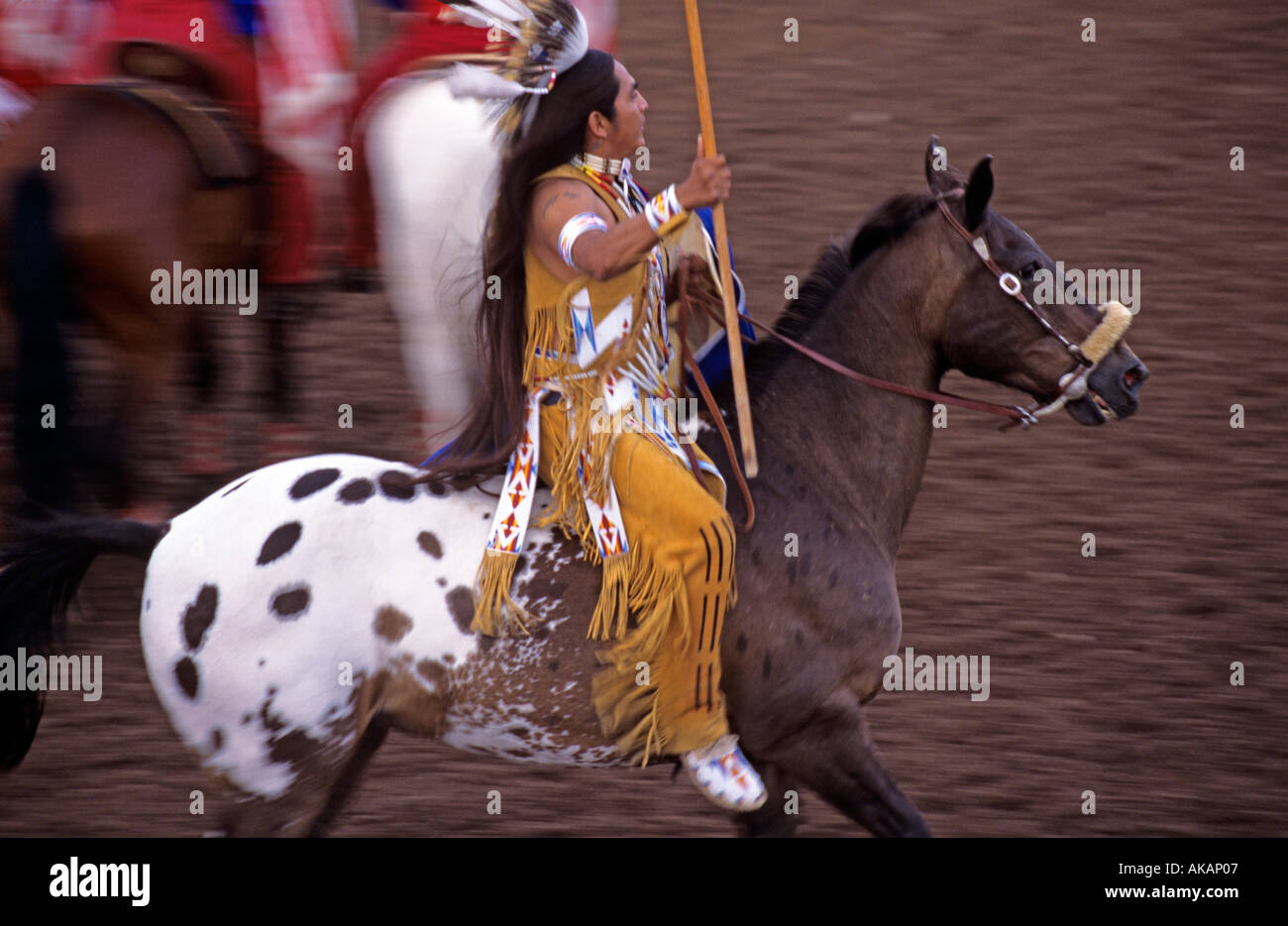 Native Indian riding display at Rodeo Vernal Utah in USA - Stock Image