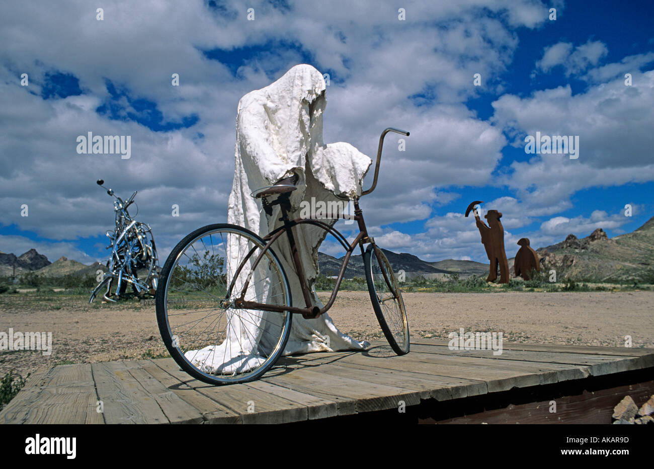 Sculpture of a ghost about to ride a bicycle near Rhyolite, a ghost town in Nevada USA - Stock Image