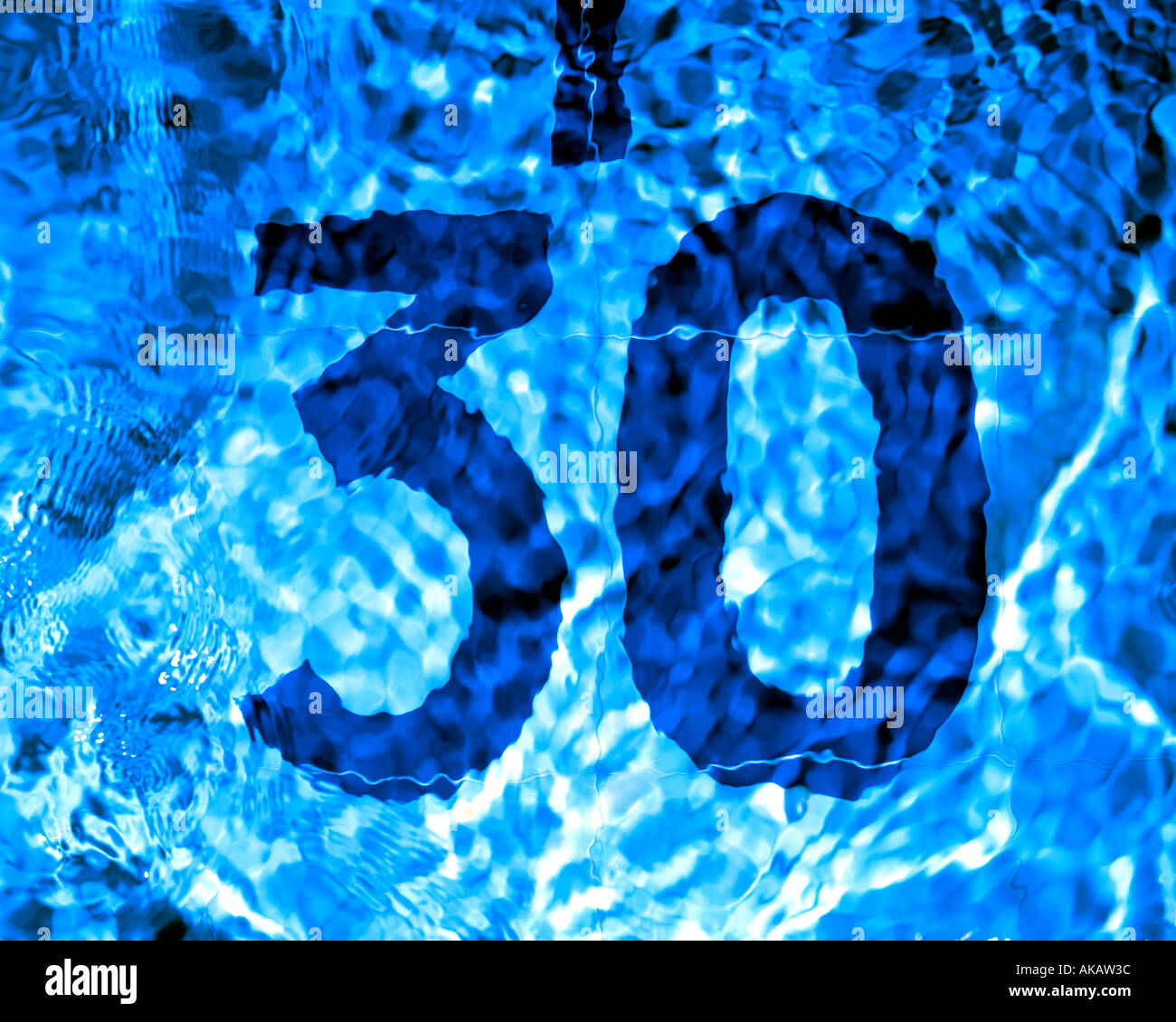 30 under water in a swimming pool - Stock Image