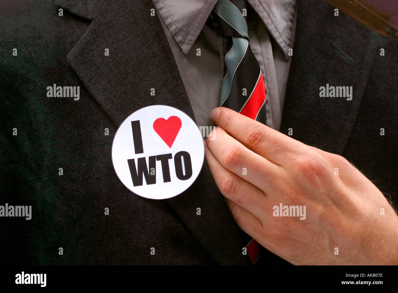 An anti globalisation activist dresses as a businessman at a protest against the World Trade organisation WTO in Stock Photo
