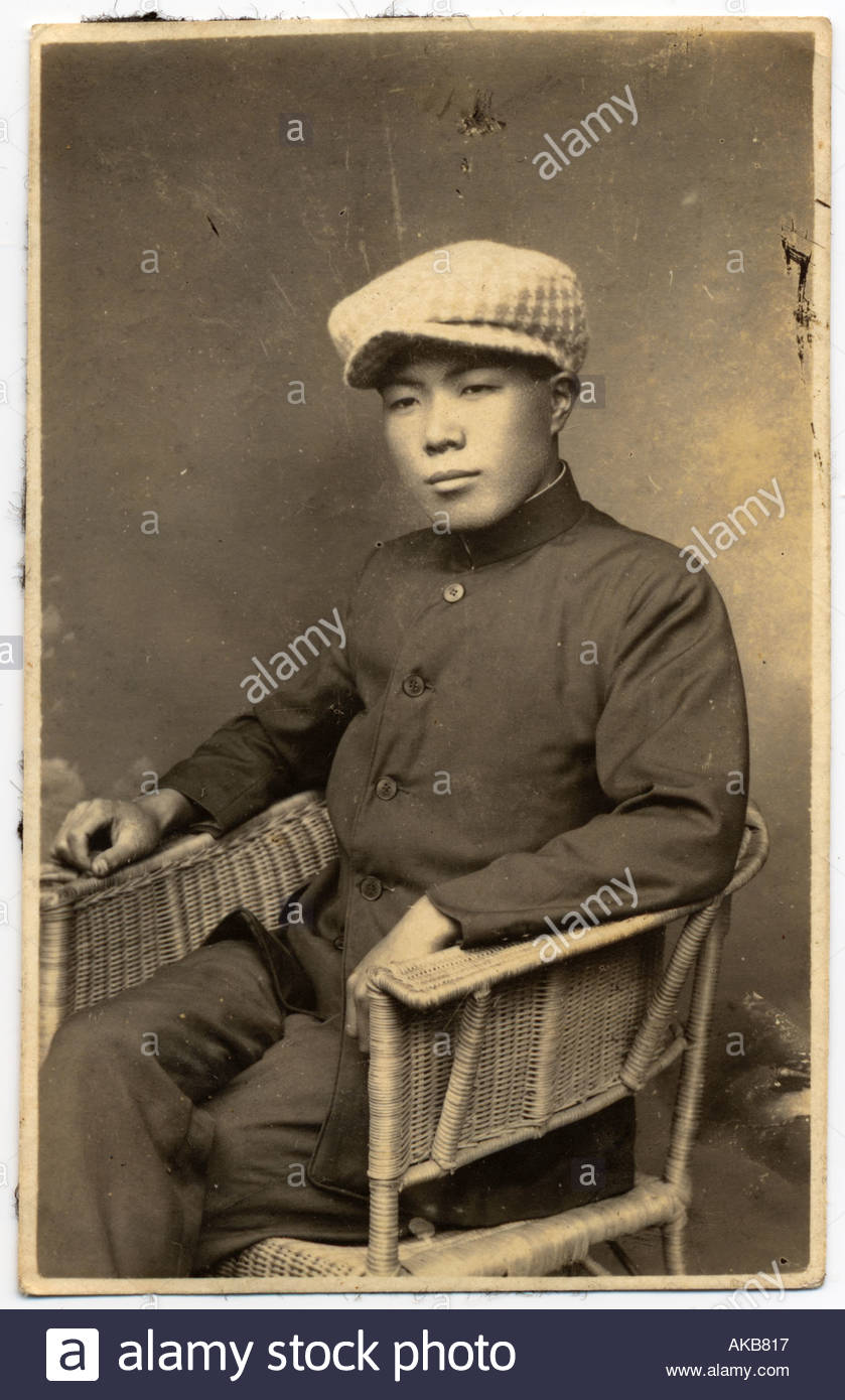 Studio portrait of an Asian man in Western style clothing - Stock Image
