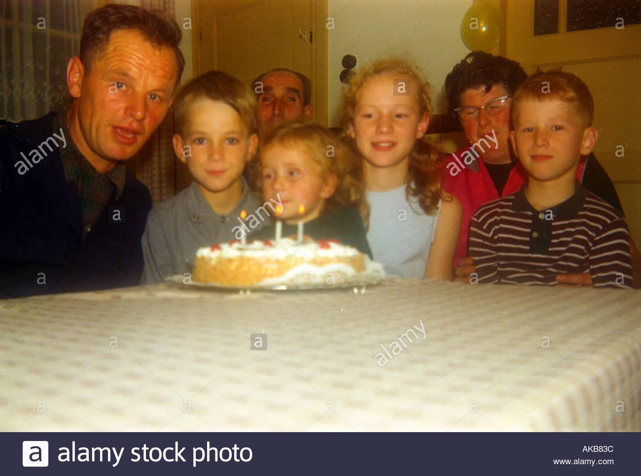 Family celebration of third birthday - Stock Image
