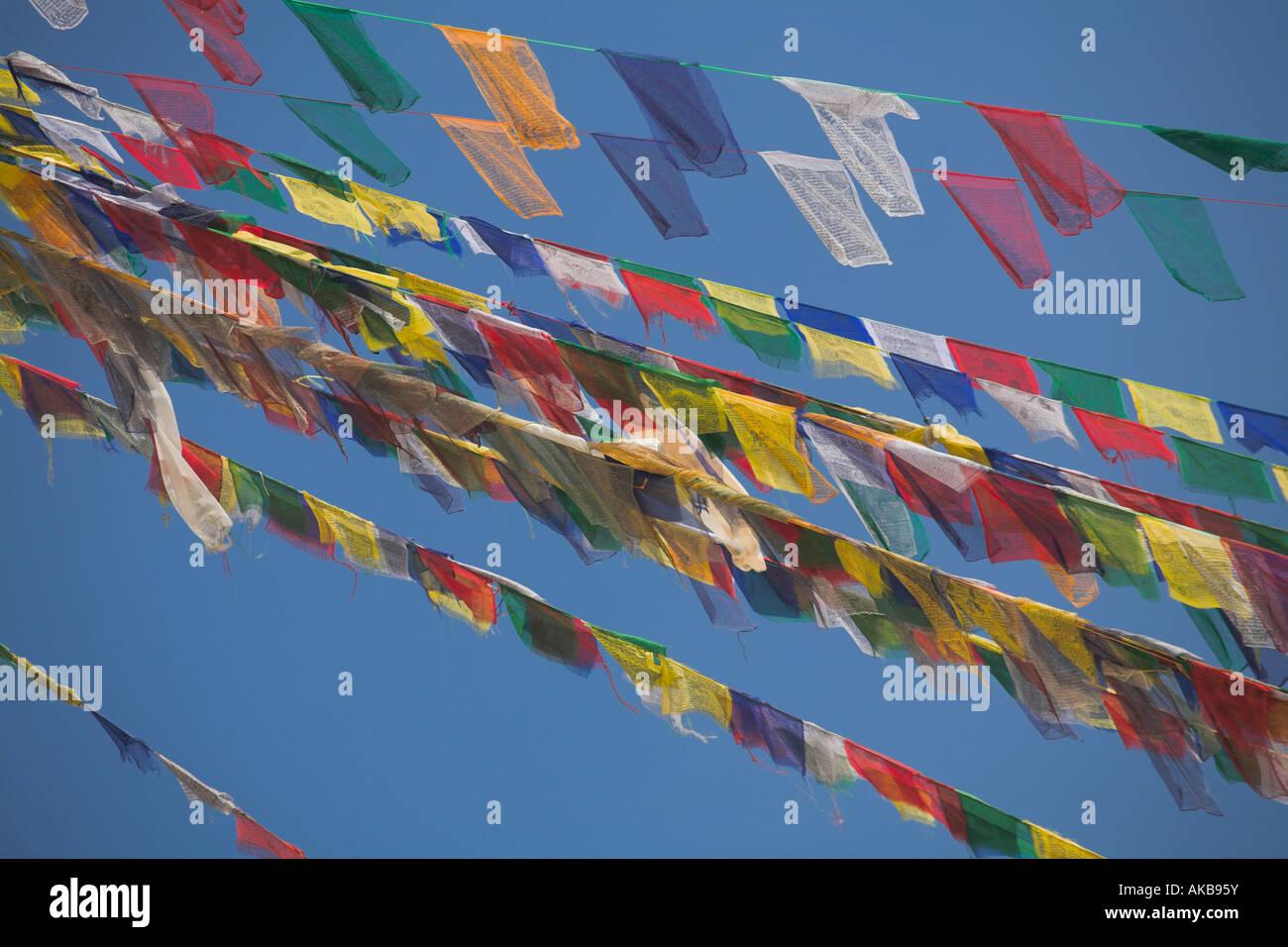 Nepal, Kathmandu, Prayer flags adorning stupa at Bodhnath Buddhist stupa, Lhosar Tibetan and Sherpa New Year festival, - Stock Image