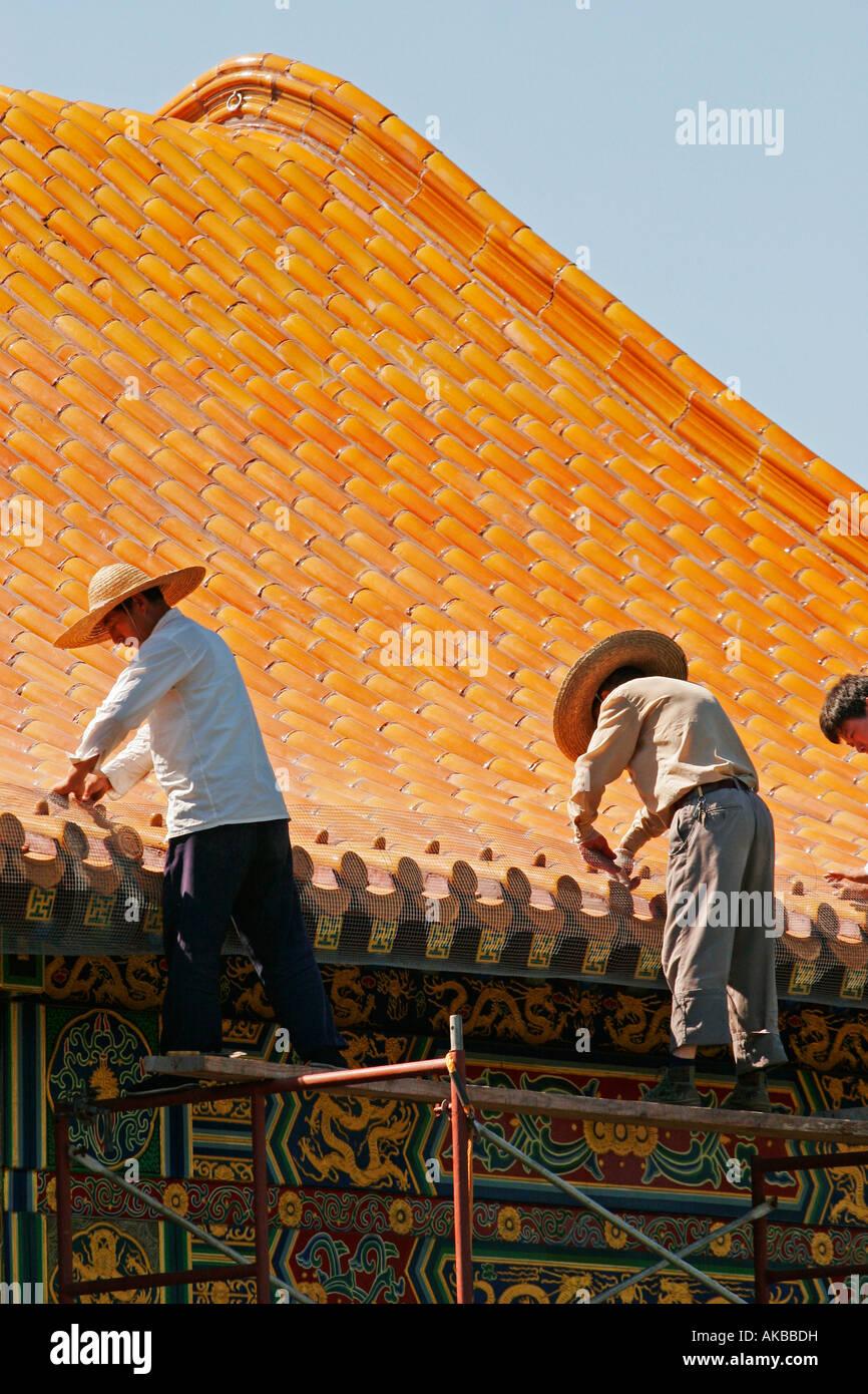 Asian workers repairing Buddhist Temple Stock Photo