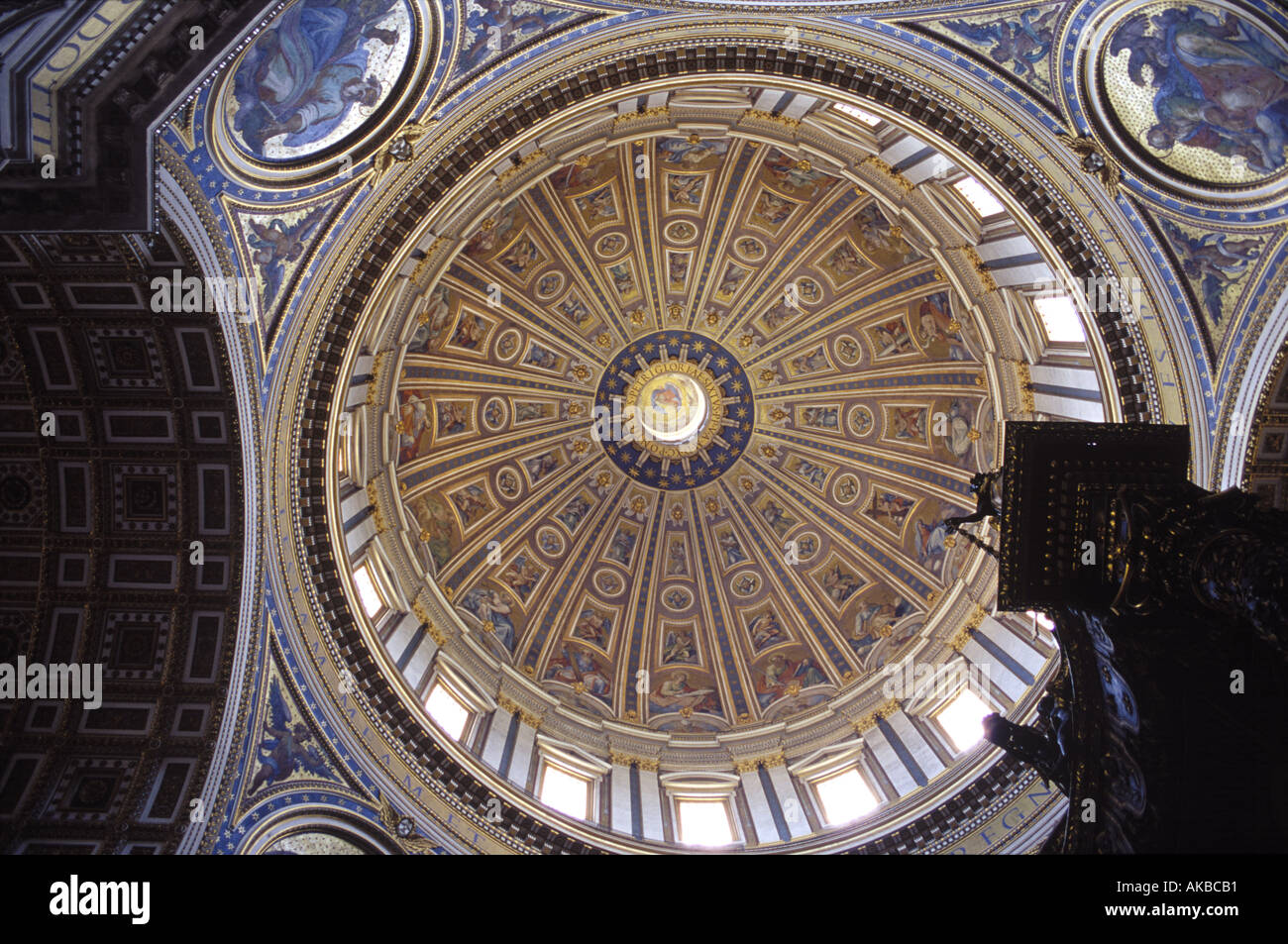 Looking up at the Michelangelo designed dome in Saint Peter s Basilica in Rome s Vatican City - Stock Image