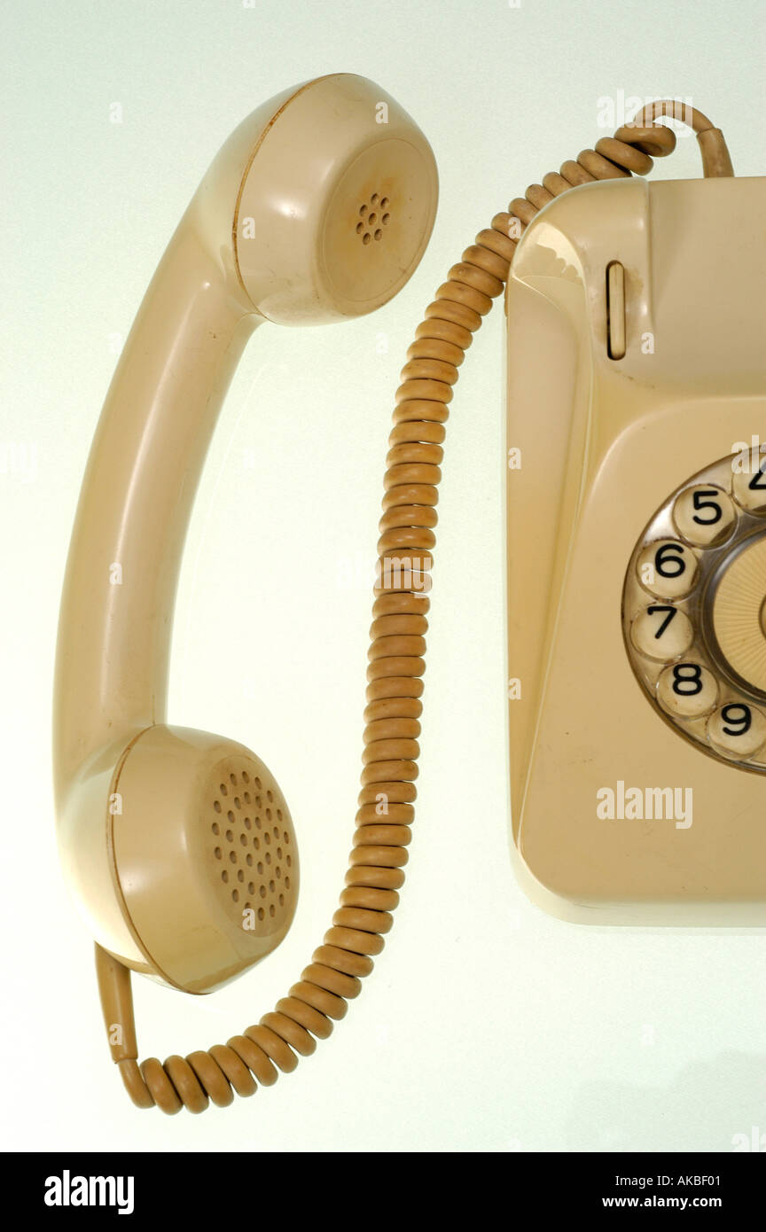 old telephone, telephone receiver beside the telephone - Stock Image