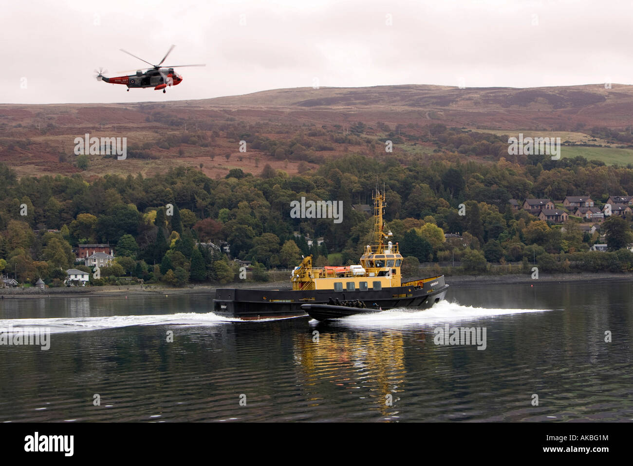 British Navy Royal Marines on a simulated drugs raid on a moving boat on Gare Loch in Scotland - Stock Image