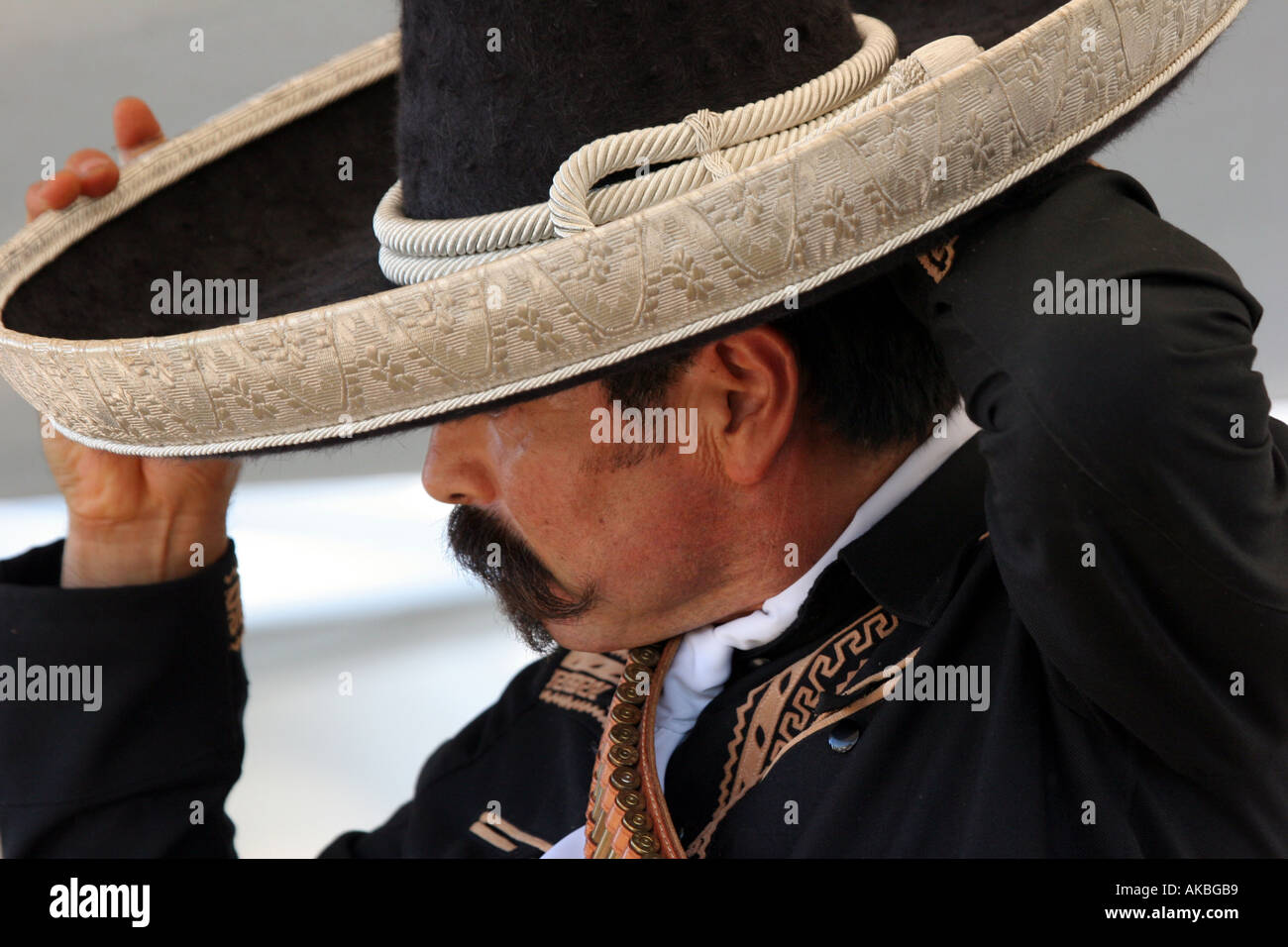 Reenactor of a Mexican cowboy fixing his sombrero at a Buffalo Bill Wild  West Show in 07d321af56e