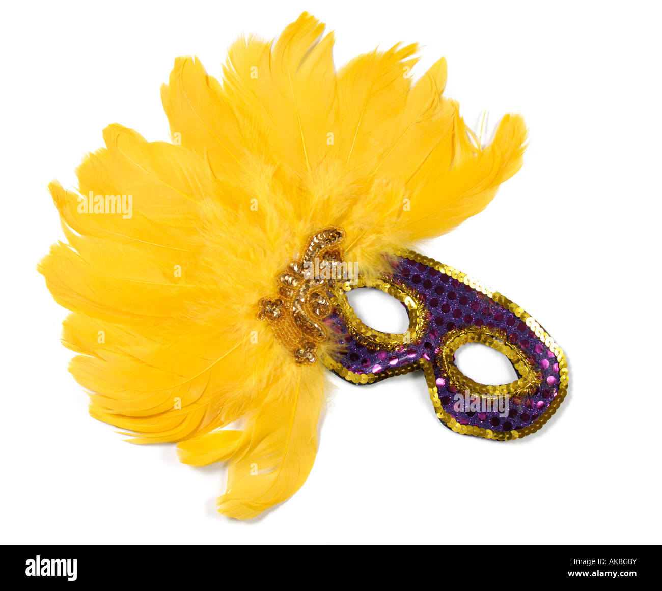 Purple carnival mask decorated with yellow bird feathers - Stock Image