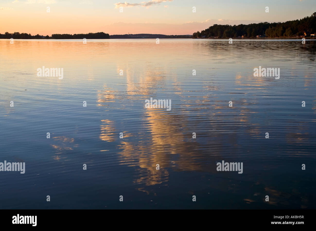 Clouds reflected in Municky Rybnik lake Hluboka Czech republic - Stock Image