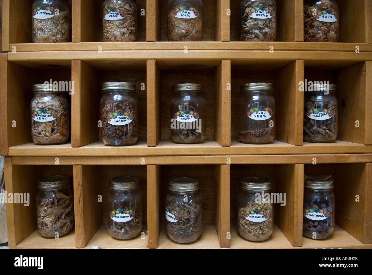 Spice rack with glass jars and labeled spice jars stock image