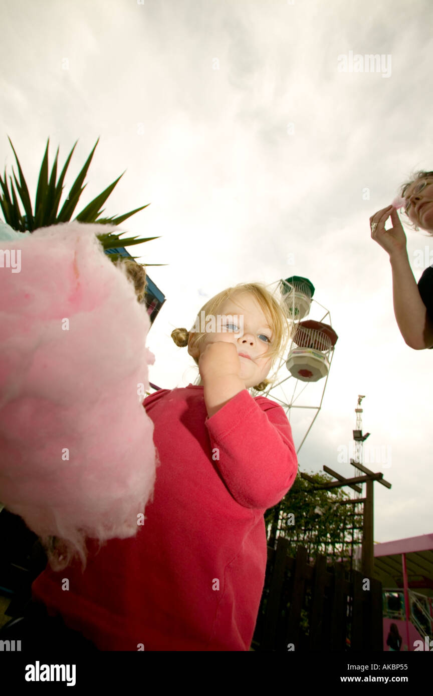 Children eating candyfloss - Stock Image