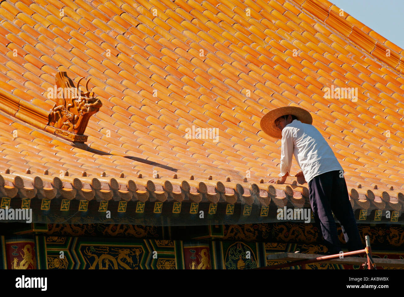 Asian workers repairing Buddhist Temple Stock Photo