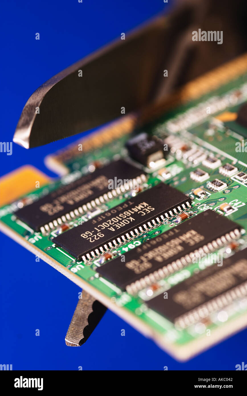 Scissors Cutting Edge Of Printed Circuit Board Blue Stock Photo Boards Images