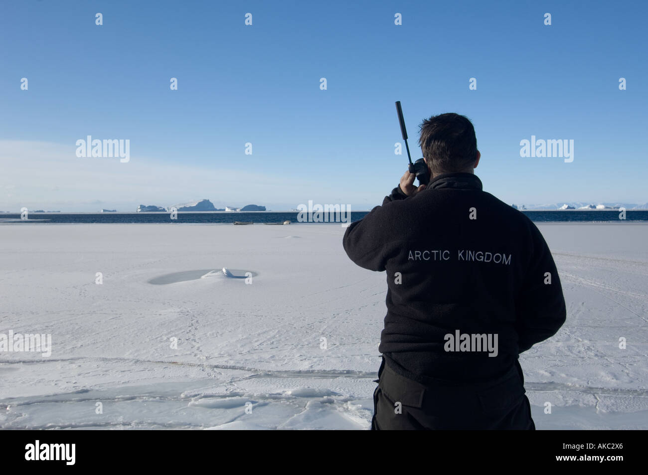 Qaanaaq Greenland Qaanaaq Greenland Using iridium satellite phone in the high Arctic Stock Photo