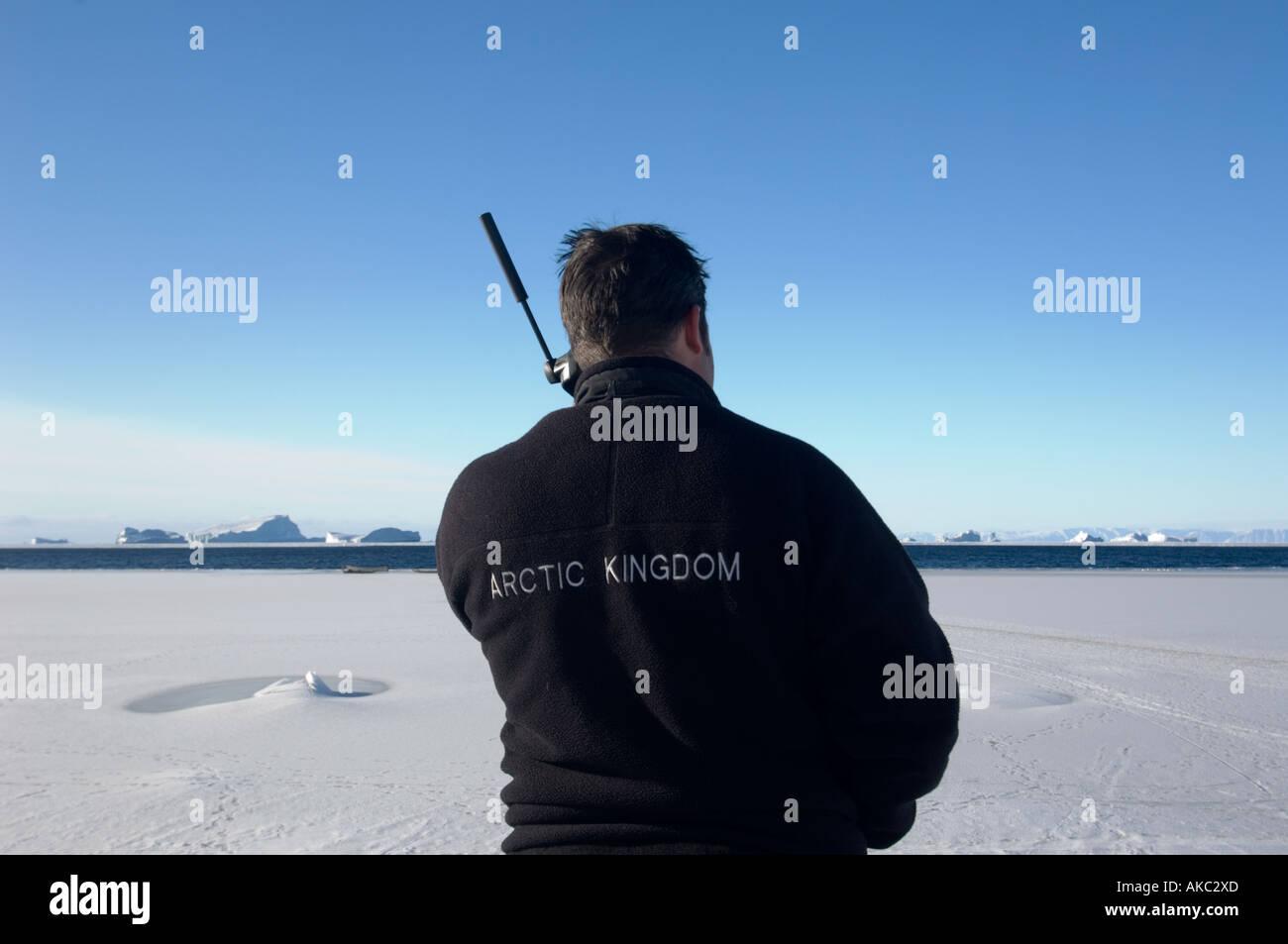 Qaanaaq GreenlandUsing iridium satellite phone in the high Arctic Stock Photo